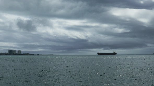 Thumbnail for Cargo Ship Passes by the Town 925