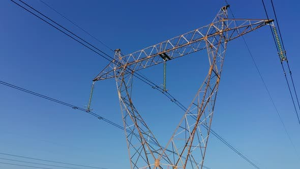 Transmission tower supporting an overhead high voltage power line - wires that transport electric