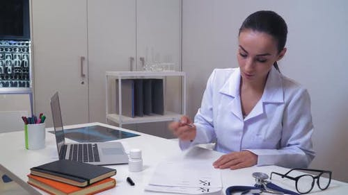 Physician Giving Rx for Patient