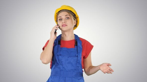 Thumbnail for Young female worker talking on phone while walking on gradient