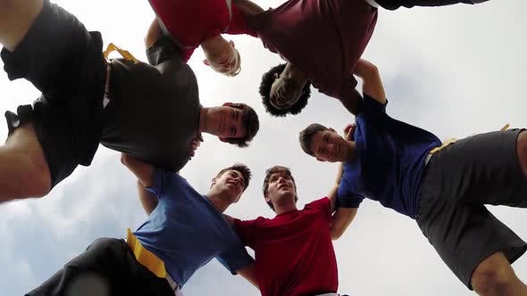 Thumbnail for A group of young men playing flag football on the beach.