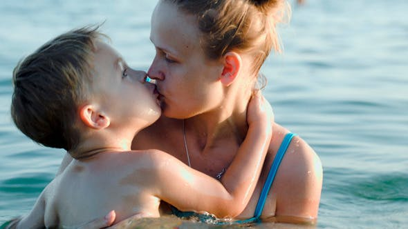 Thumbnail for Son And Mother Bathing In Sea