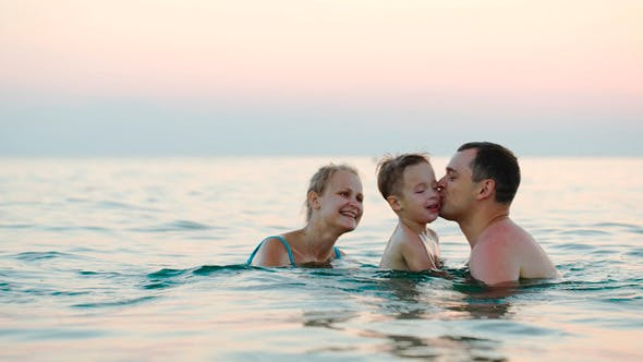 Thumbnail for Happy Family Of Three Bathing In Sea