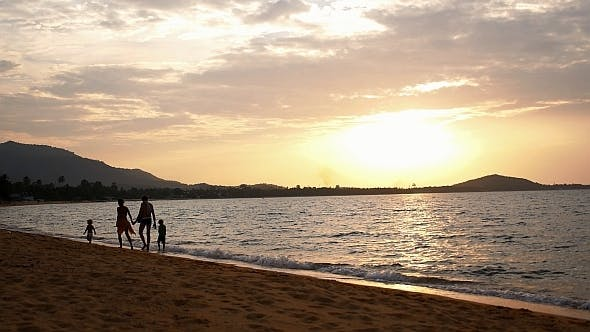 Thumbnail for Happy Family Walking on Beach