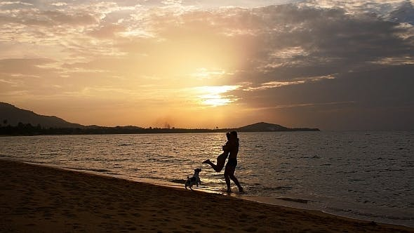 Thumbnail for Couple Running Towards Each Other at Sunset