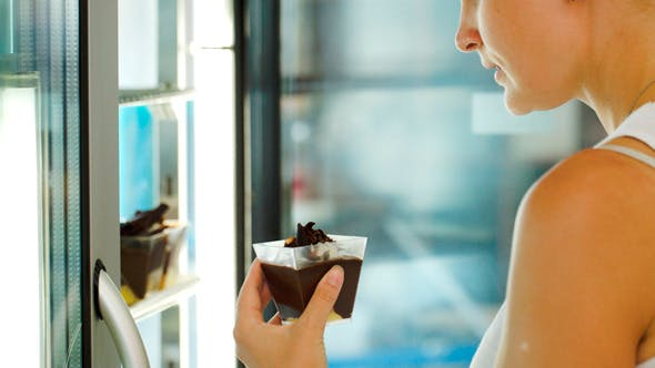 Thumbnail for Woman Taking Cake From Fridge At The Shop