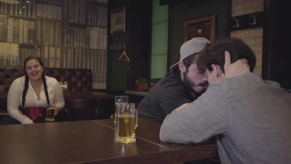 Thumbnail for Two Men Sitting at a Table in a Bar, Engaged in Arm Wrestling
