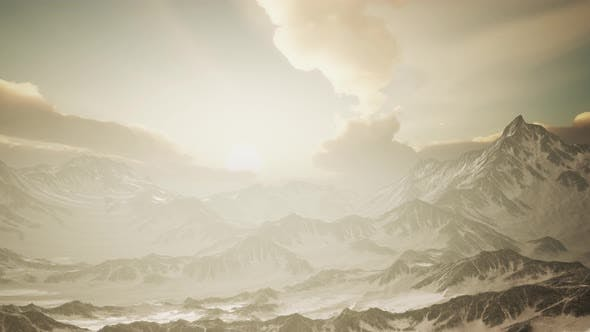Panorama of High Snow Mountains at Sunset
