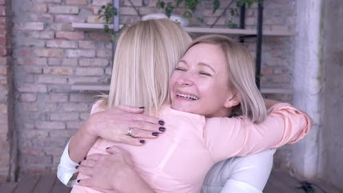 Maternal Tenderness, Merry Smiling Mama Take Pleasure Communication with Adult Daughter and Hug