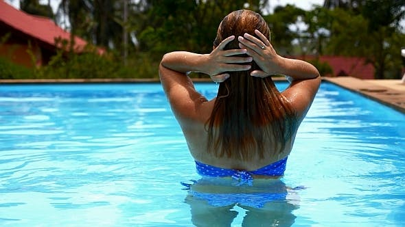 Thumbnail for Woman Emerging from Water in Swimming Pool