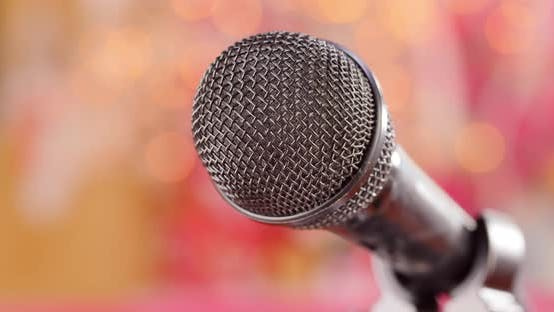 Thumbnail for Microphone on Stage Against a Blurry Light ,Blurry Background