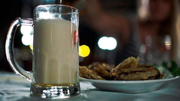 Thumbnail for Pouring Beer With Foam Into Glass Mug