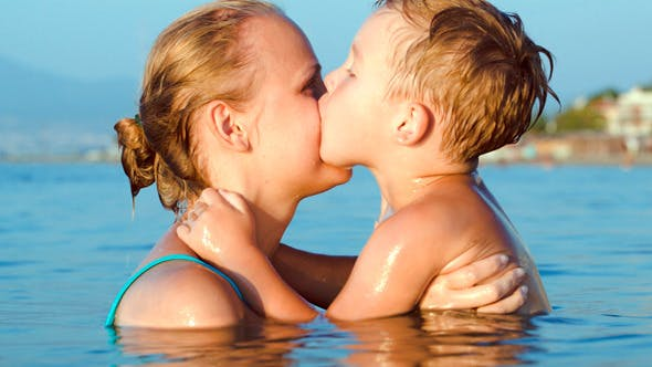 Thumbnail for Boy Kissing And Embracing Mother In Sea