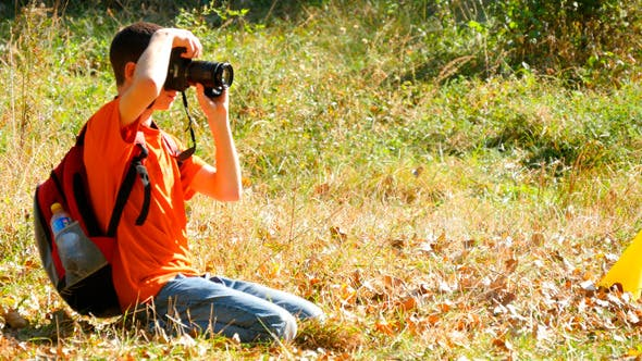 Thumbnail for Young Boy Taking Photos With Dslr