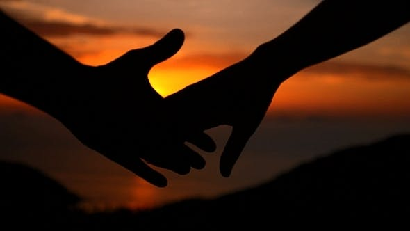 Cover Image for Holding Hands at Sunset