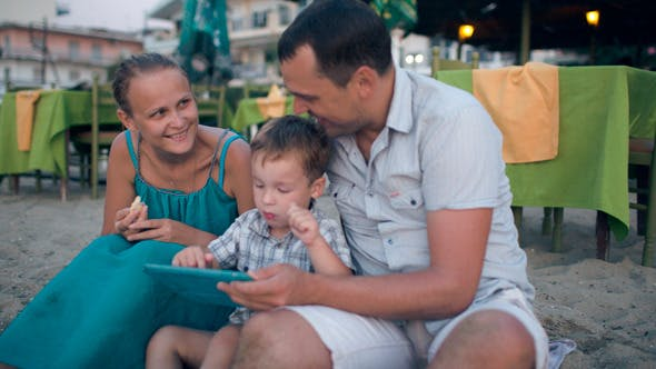 Thumbnail for Family Of Three On Resort With Tablet Pc