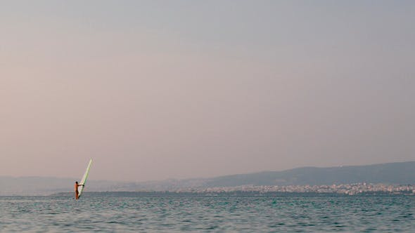 Thumbnail for Windsurfer Sailing In Quiet Sea