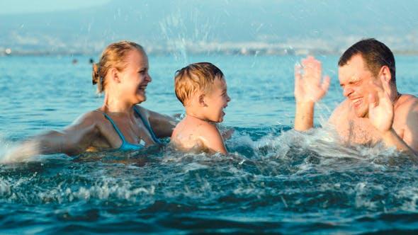 Thumbnail for Happy Family Having Fun In Sea Water