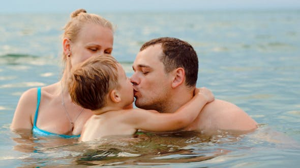 Thumbnail for Lovely Family With Child Bathing In Sea