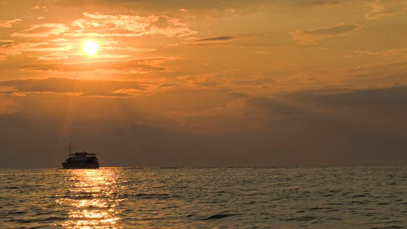 Cover Image for Sailing Ship In Quiet Sea At Sunset