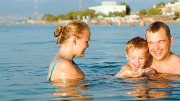 Thumbnail for Happy Parents And Son Bathing In Sea On Resort