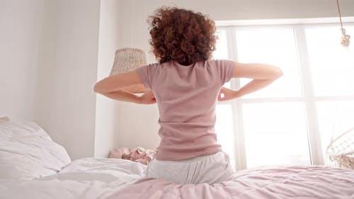 Female in Pajamas Stretch in Apartment