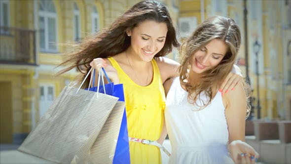 Thumbnail for Young Cheerful Girl Shopaholic Posing With Shoppin