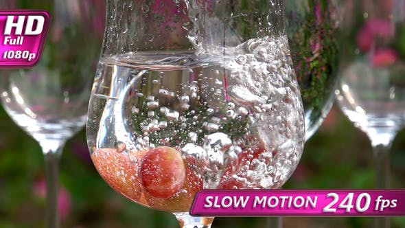 Thumbnail for Water is Pouring into a Glass with Grapes