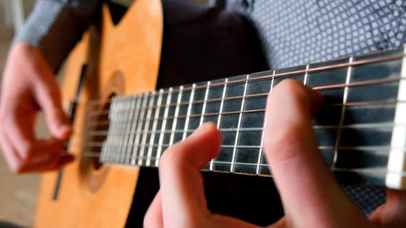 Thumbnail for Strumming Playing Acoustic Guitar 2