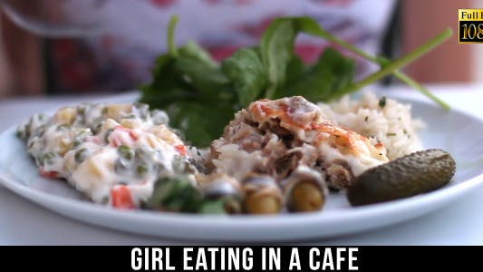 Thumbnail for Girl Eating In A Cafe 3