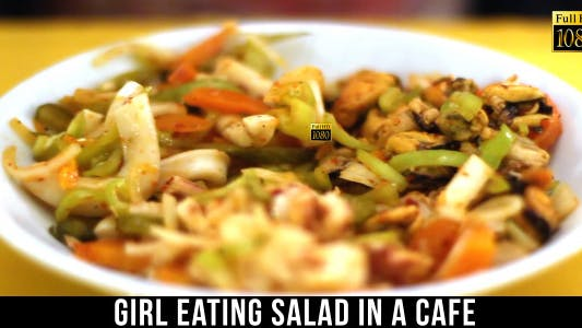 Thumbnail for Girl Eating Salad In A Cafe 2