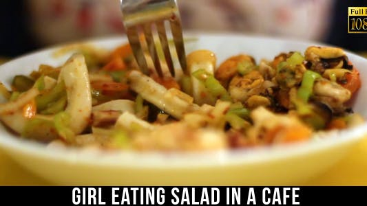 Cover Image for Girl Eating Salad In A Cafe 3