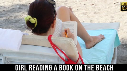 Thumbnail for Girl Reading A Book On The Beach