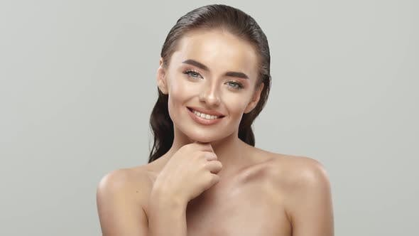 Thumbnail for Beautiful Woman with Fresh Clean Skin Stroking Her Face