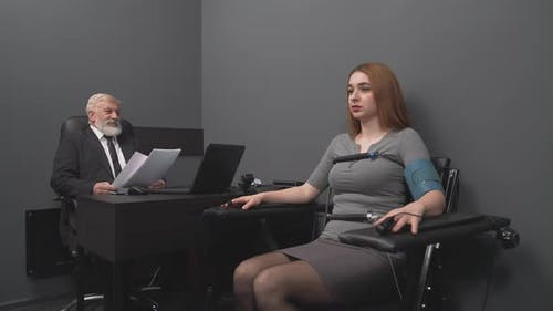 Concentrated Young Lady Telling Truth During Polygraph Test