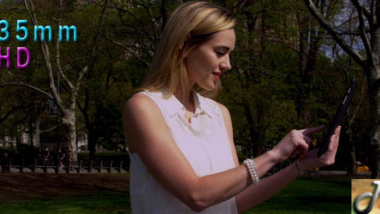 Thumbnail for Woman In Central Park With Tablet