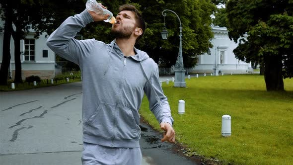 Thumbnail for Sportsman Drink Clean Water From Bottle Splashing Water.