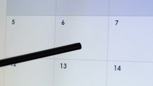 Person Typing Deadline in Calendar Application, Project Timeline, Weekly Reports