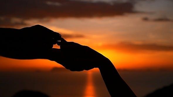 Thumbnail for Putting Wedding Ring at Sunset