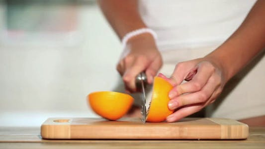 Thumbnail for Girl Cutting Orange