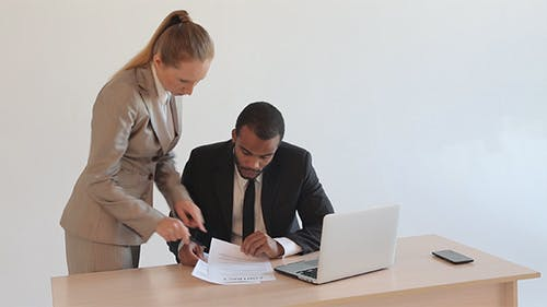 Secretary Brings Documents for Boss