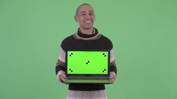 Thumbnail for Happy Bald Multi Ethnic Man Thinking While Showing Laptop and Talking