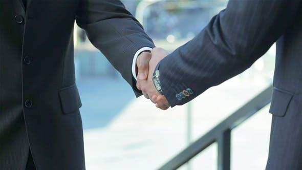 Thumbnail for Two Confident Businessman Handshake