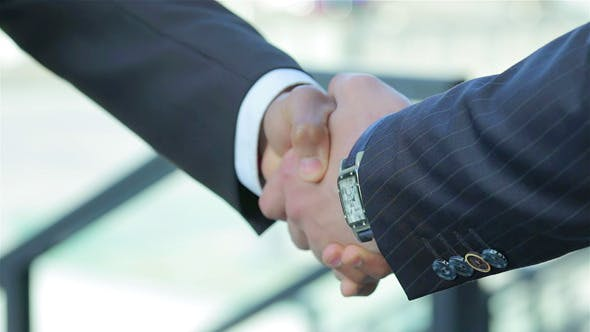 Thumbnail for Two Confident Businessman Handshake on Good Deal