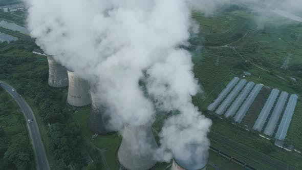 Aerial Drone View of Smoking Pipes and Cooling Towers of Coal Thermal Power Plant