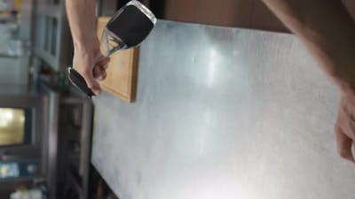 Chef Disinfecting And Cleaning Kitchen Table