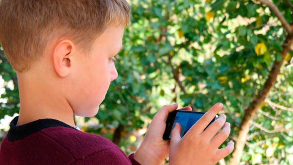 Thumbnail for Boy Viewing Pictures On Smartphone