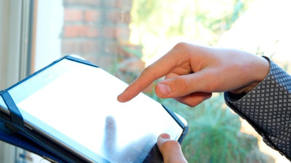 Thumbnail for Male Hands Typing On Tablet