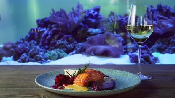 Thumbnail for Plate with Salmon Steak Near Aquarium.