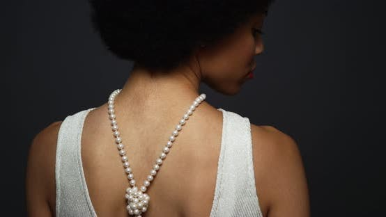 Thumbnail for Black woman wearing elegant pearl necklace